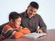 father and son studying bible